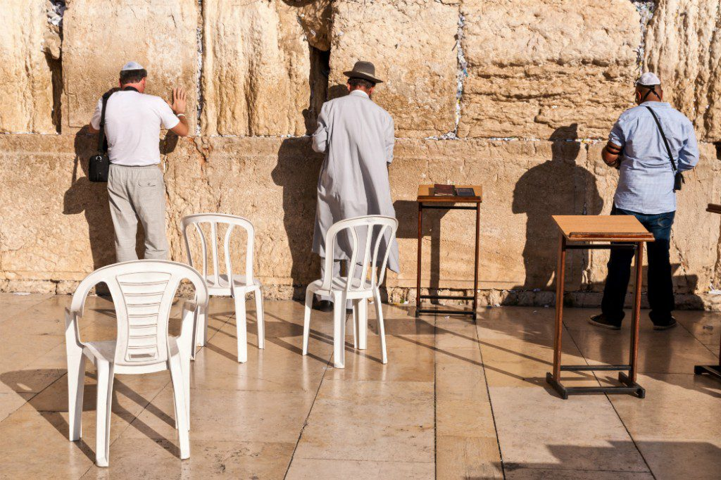 Holy Land: Men praying in front of the Wailing Wall