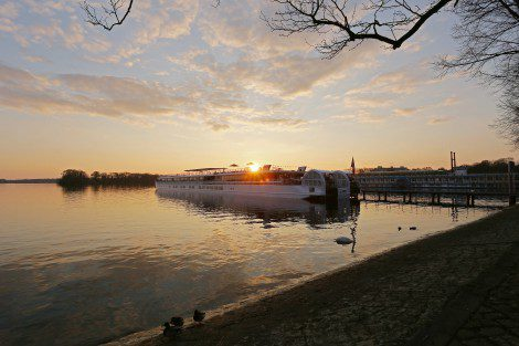 Berlin at sunset with the Elbe Princesse