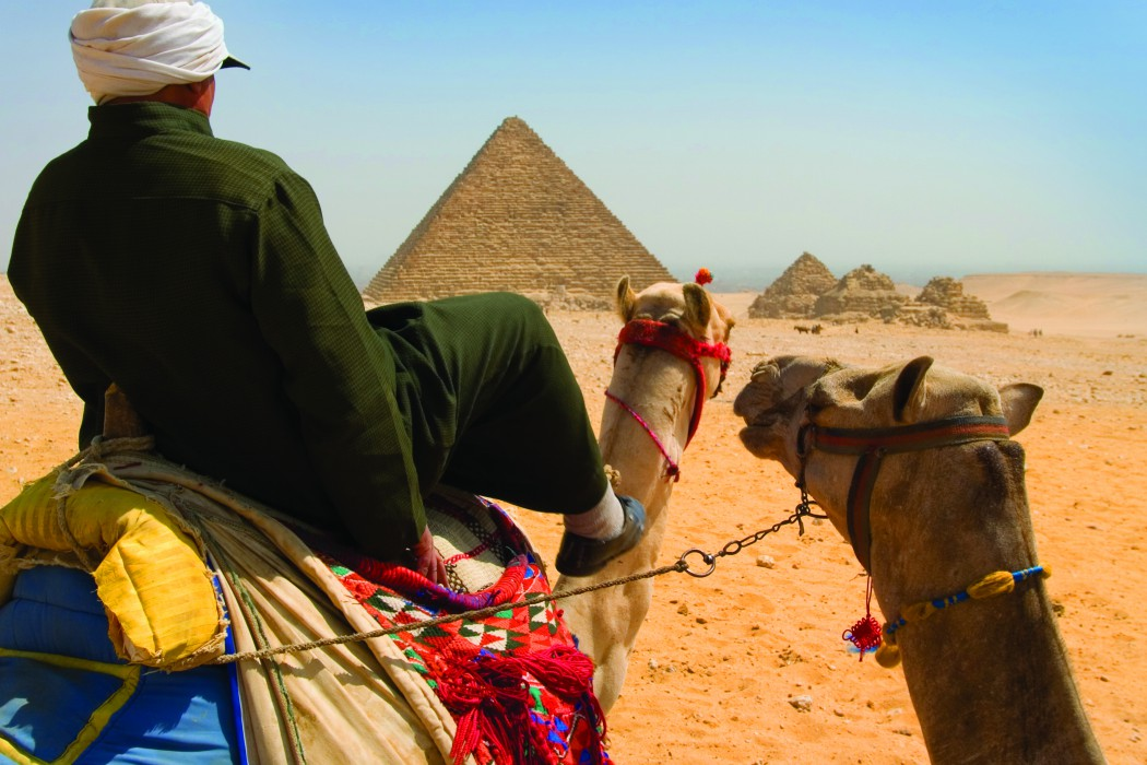 bigstockphoto_Camel_Riding_Near_Pyramids_1251199