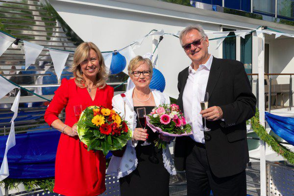 AmaWaterways' co-owners Kristin Karst (left) and Rudi Schreiner (right), with godmother  Filomena Andre of AAA Travel.