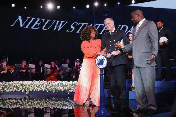 FORT LAUDERDALE, FL - FEBRUARY 02:  Godmother Oprah Winfrey, Captain Sybe de Boer and President Holland America Line Orlando Ashford speas onstage during the Holland America Line and Nieuw Statendam Dedication with Godmother Oprah Winfrey at Port Everglades on February 2, 2019 in Fort Lauderdale, Florida.  (Photo by John Parra/Getty Images for Holland America) *** Local Caption *** Oprah Winfrey;Sybe de Boer;Orlando Ashford