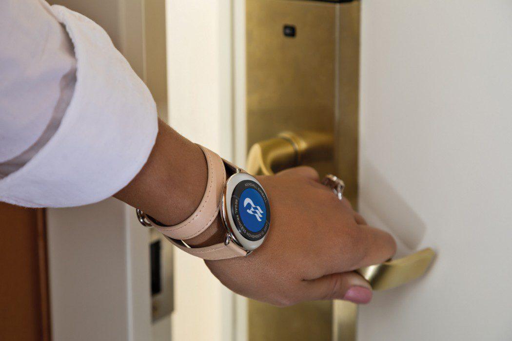 Ocean-Medallion-Close-up---Guest-Opening-Stateroom-Door